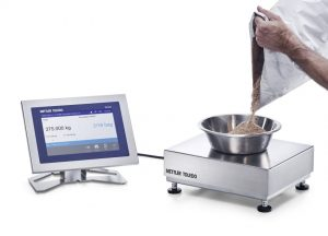 Form+ formulation software pouring ingredient onto scale